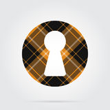 Orange, black tartan isolated icon - keyhole. Orange, black isolated tartan icon with white stripes - keyhole and shadow in front of a gray background Royalty Free Stock Images