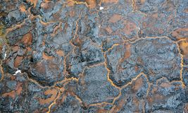 Burnt wall. Insulation foam charred on party wall. Orange and black abstract background stock images