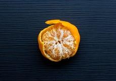 Orange on black wood Royalty Free Stock Photos