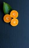 Orange on black wood Stock Photo