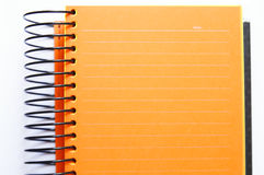 Orange blank notebook. Orange blank of lined notebook Stock Photos