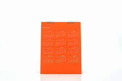 Orange blank paper desk spiral calendar 2016. Orange blank paper desk spiral calendar 2016  on white background Royalty Free Stock Photos