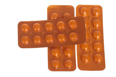 Orange blister pills ,isolated Royalty Free Stock Image