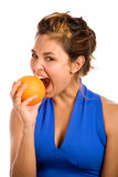 Orange & Blue 3. Healthy Girl Biting an Orange Royalty Free Stock Image