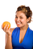 Orange & Blue 5. Healthy Girl Happily Holding an Orange Stock Photo