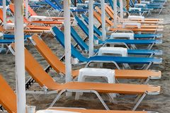 Arranged beach beds and tables stock image