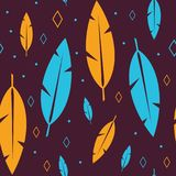 Orange and Blue Boho Feathers Repeating Seamless Background. Orange and blue feathers with dots and diamonds on a brown background. Seamless repeating pattern Stock Image