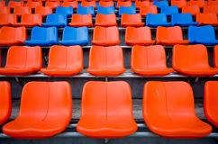Orange and blue chair on grandstand Royalty Free Stock Images