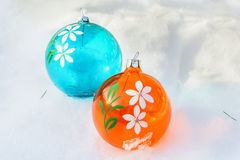 Orange and blue Christmas balls on snow Royalty Free Stock Photography