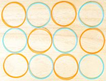 Orange and blue circle on wood background. Abstract background royalty free stock photos