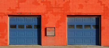Orange and blue garage doors Stock Photo