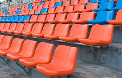 Orange and blue grandstand chairs Stock Photos