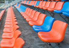 Orange and blue grandstand chairs Royalty Free Stock Photos