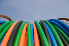 Orange, blue, green telecommunication cables Stock Photo