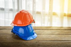 Orange, blue hard safety helmet construction hat for safety proj Royalty Free Stock Photo