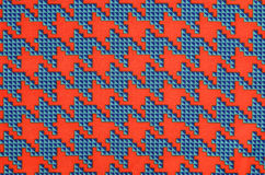 Orange and blue houndstooth pattern. Stock Photography