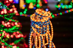 Orange and blue LED strips as Christmas decor. Orange and blue LED strips used as Christmas light decorations, wrapped around the pole stock images