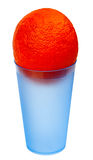 An orange in a blue plastic glass. Isolated on a white background Stock Photo