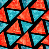 Orange and blue polygons on a black background. Geometric seamless pattern. Royalty Free Stock Photos