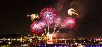 Orange, blue, and red fireworks over the Saint-Lawrence River stock photo