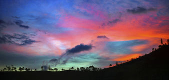Orange and Blue Sky over Mountain Stock Images