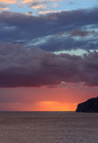 Orange blue skyscape. After storm in October. Sant Elm, Mallorca, Balearic islands, Spain Stock Photo