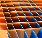 Orange and blue squares. Orange and blue square dividers in a box Stock Image