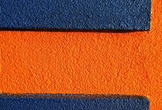 Orange & blue stucco 1. Orange stucco walls have great texture! This building has a lively combination of intense orange and blue royalty free stock photo
