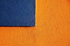 Orange & blue stucco 3. Orange stucco walls have great texture! This building has a lively combination of intense orange and blue royalty free stock images