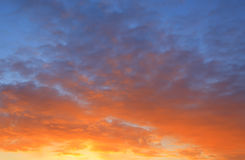 Orange and blue sunrise Stock Photos