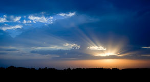 Orange And Blue Sunset. Beautiful dynamic sky royalty free stock images
