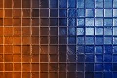 Orange and blue tiles wall texture. Modern orange and blue tile wall texture for interior Royalty Free Stock Photos