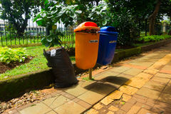 Orange and blue trash bin photo taken in Jakarta Indonesia stock image