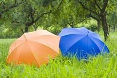 Orange and blue umbrellas stock photo