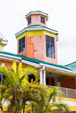 Orange Blue and Yellow Plaster Building in Nassau Stock Images