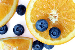 Orange and blueberry. With white background Royalty Free Stock Photo