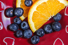 Orange and blueberry close up Stock Images