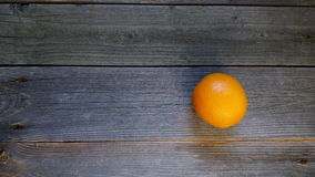 Orange on the boards Stock Images
