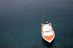 Orange boat. Floating on oceans water Royalty Free Stock Photo