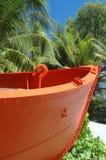Orange boat beach Bequia St. Vincent Stock Photo