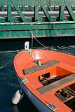 Orange boat and green bridge Stock Photo