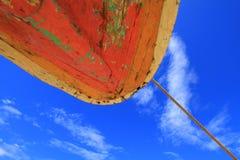 Orange Boat Hull. Against blue sky at Sendang Biru Beach, Malang, Indonesia Stock Image