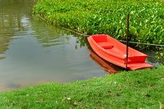 Orange boat in lake Stock Photography