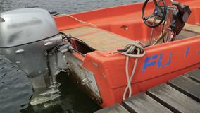 Orange boat with a motor on sea stock video footage