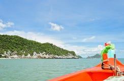 Orange boat sailing Royalty Free Stock Images