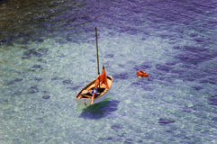Orange boat on the sea. This photo is made in portals nous, mallorca, spain Stock Photos