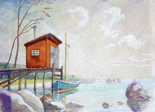 Orange boat shed in a low tide. Royalty Free Stock Photography