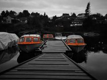Orange boats. Lovely lake with orange boats Royalty Free Stock Photography