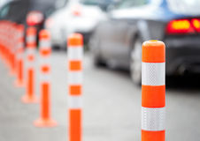 Orange bollard on the road. Royalty Free Stock Photography