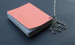 Orange book 2. Orange book and metal  chain Royalty Free Stock Photography